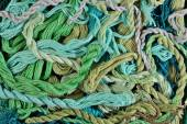 Colorful embroidery floss as background texture — Stock Photo