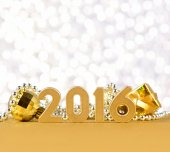 2016 year golden figures and Christmas decorations — Stock Photo