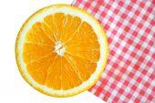 Sliced orange fruit on table cloth, isolate on white background. — Stock Photo