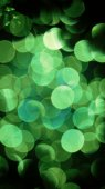 Green bokeh on a dark background — Stock Photo