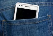 Close up of smart phone in pocket jeans — Stock Photo