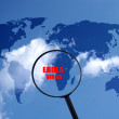 Ebola danger in west Africa, world map and magnifying glass — Stock Photo #57649653