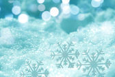 Ice crystal on snow in blurred background — Stock Photo