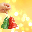 Child holding golden Christmas tree decorations on lights background — Stock Photo #59803565