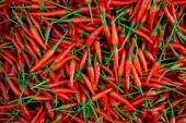 A pile of small, red, very hot and spicy chilli peppers on an asian market. — Stock Photo
