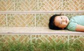 Portrait of a sweet girl lay on the steps — Stock Photo