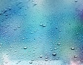 Abstract blue background. Liquid on dirty glass. (selective focus) — Stock Photo