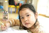 Little school girl doing homework — Stock Photo