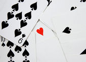 Background of cards with heart of ace (standing out from the crowd) — 图库照片