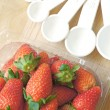 Measuring spoons cup with strawberry — Stock Photo #67387841