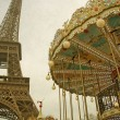 Retro tone of Carousel and Eiffel Tower in Paris on a background of foggy sky — Stock Photo #68002021