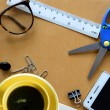 Yellow coffee cup and office supplies. View from above — Stock Photo #76769345