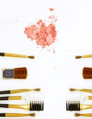 Cosmetic powder brush and crushed blush palette isolated on white — Stock Photo