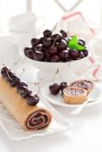 Cake roll with cherry jam — Stock Photo