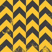 Yellow chevron pattern with distressed texture — Stock Vector