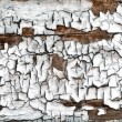 Cracked dried paint on an old wooden board — Stock Photo #53433631