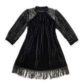 Stylish black dress with a fringe — Stockfoto