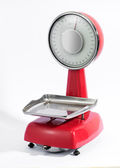 Vintage red scale with pan — Stock Photo