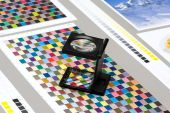 Close up Small Loupe on Top of Color Guide — Stock Photo