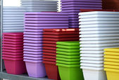 Colorful Flower Plant Pots Piled on the Table — Stock Photo