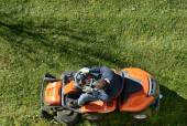 Man mowing a lawn on a ride-on mower — Stock Photo