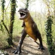 Allosaurus Dinosaur Statue Standing at the Forest — Stock Photo #70937867