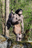 Model of Neanderthal Hunter Carrying Pig — Stock Photo