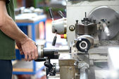 Blue-collar worker doing manual labor with a lathe — Stock Photo