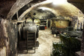 Interior of a vaulted wine cellar with old casks — Stock Photo
