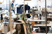 Tailors shop with equipment and work benches — Stock Photo