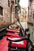 Taking a tour in a Venetian gondola — Stock Photo