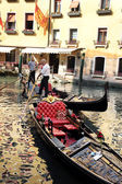Gondoliers in a venetian canal — Stock Photo