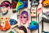 Plenty of venetian carnival masks — Stock Photo