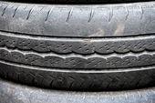 Old worn motor vehicle tire — Stock Photo