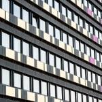 External facade of a hotel with multiple windows — Stock Photo #81388070