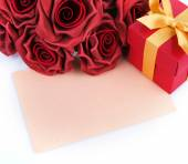 Blank card with red flowers and gift — ストック写真