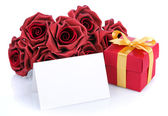 Card with red flowers and gift — Stock Photo