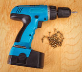 Electric drill and screws — Stock Photo