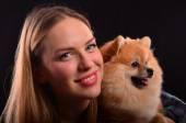 Beautiful girl and Pomeranian dog — Stock Photo