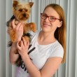 Girl holding Yorky dog — Stockfoto #59323553