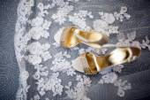 Pretty shot of wedding shoes and wedding dress — Stock Photo