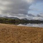 Loch Morlich beach panorama — Stock Photo #71840347