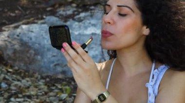 Woman applies makeup lipstick — Stock Video