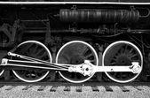 Black and white steam engine wheels. — Stock Photo