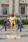 Living statue street performer — Stock Photo