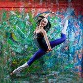 Girl jump of art graffiti — Stock Photo
