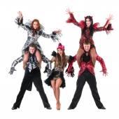 Dancer team wearing carnival costumes dancing — Stock Photo