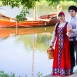 Young couple near the river — Stock Photo #69442541