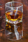 Golden Brown Whisky on the rocks in a glass — Stock Photo