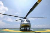 Helicopter parking landing on offshore platform. Helicopter transfer crews or passenger to work in offshore oil and gas industry. — Stock Photo